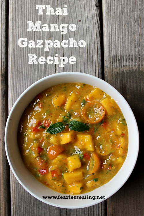 This refreshing Thai mango gazpacho recipe consists of lime juice,Thai basil, mint and tomatoes and makes for a perfect cold soup on a hot summer day.