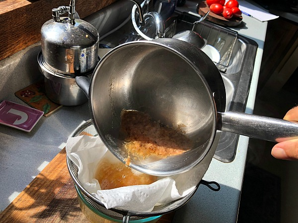 straining the japanese dashi broth