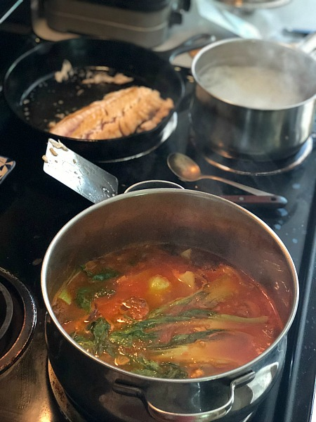 japanese tomato noodle soup on the stovetop