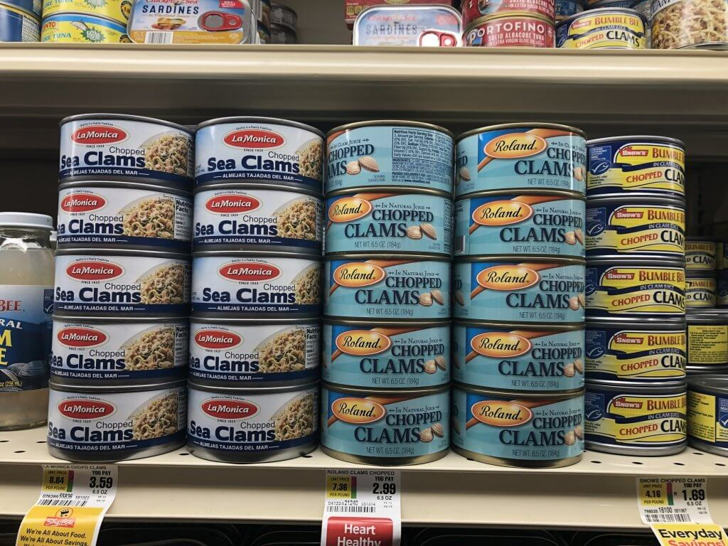 canned sea clam stacked in a supermarket